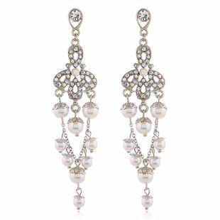 Pendientes largos coreanos de perlas y diamantes de flores silvestres pendientes de borla dulce al por mayor nihaojewelry NHVA230804's discount tags