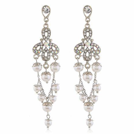 Boucles d'oreilles coréenne longue perle et diamant fleur sauvage boucles d'oreilles gland doux en gros nihaojewelry NHVA230804's discount tags