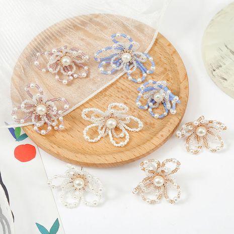 Creative argent aiguille coréenne mignon à la main cristal fleur boucles d'oreilles tendance perle armure boucles d'oreilles en gros nihaojewelry NHLA230828's discount tags