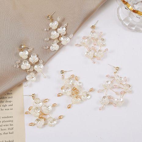 Pendientes de flores de cristal tejidas con tendencia coreana de aguja Pendientes de concha de imitación hechos a mano al por mayor nihaojewelry NHLA230830's discount tags