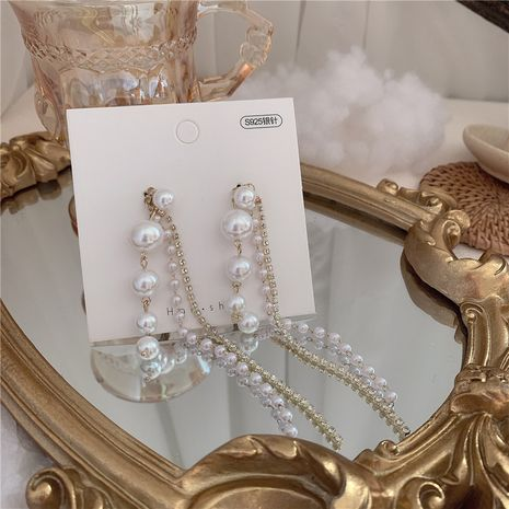Moda simple S925 aguja de plata tamaño perla rhinestone cadena borla pendientes al por mayor nihaojewelry NHYQ230835's discount tags