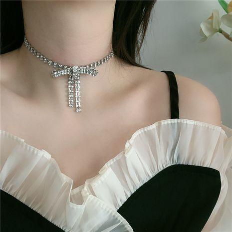 Korean girl flash diamond bow tassel neck chain short simple clavicle chain choker wholesale nihaojewelry NHYQ230859's discount tags