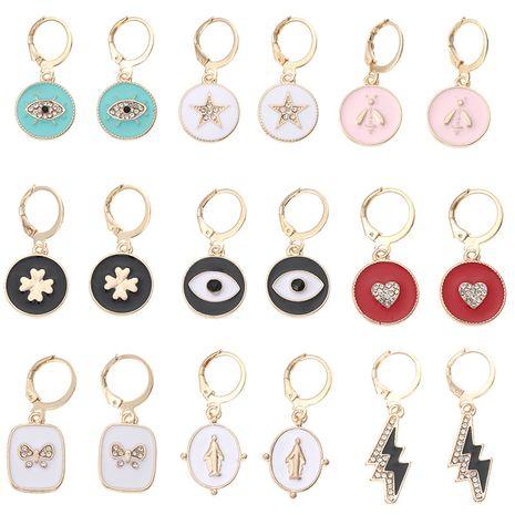 bijoux de mode alliage peinture à l'huile yeux boucles d'oreilles portrait papillon petites boucles d'oreilles en gros nihaojewelry NHNZ230930's discount tags
