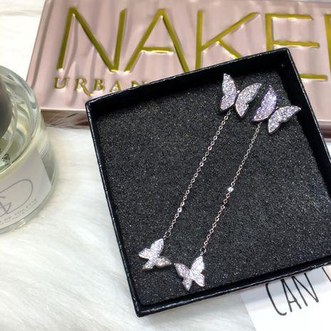 Nueva 925 aguja de plata moda mariposa pendientes largos borla pendientes de doble uso al por mayor nihaojewelry NHXI230968's discount tags