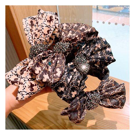 Korean retro silk printing wild bow full diamond wide-brimmed hairpin wholesale nihaojewelry NHHD231078's discount tags