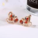 nouvelle mode incruste de boucles doreilles papillon en diamant color plein de boucles doreilles papillon creux en diamant en gros nihaojewelry NHMO235911