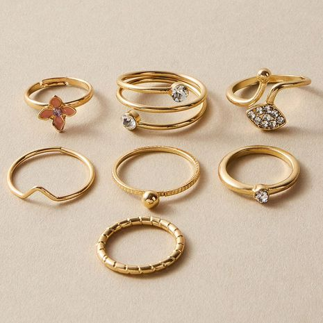 The new sweet Korean style pink oil drip flower ring 7-piece set diamond v-shaped zircon ring wholesale nihaojewelry NHGY236052's discount tags
