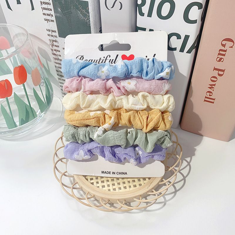 Korean hair accessories suit large intestine hair scrunchies daisy girl head rope rubber band wholesale nihaojewelry NHOF236095