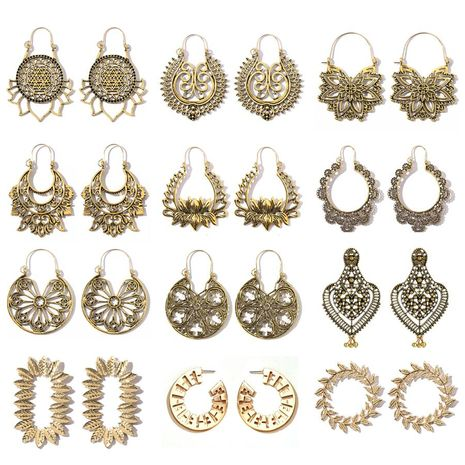 Retro ethnic style earrings fashion all-match alloy geometric hollow gold exaggerated long earrings wholesale nihaojewelry NHGY236260's discount tags