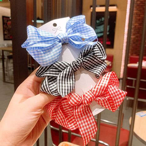 Korean side clip girl sweet hair accessories red plaid bow hairpin wholesale nihaojewelry NHSA236183's discount tags