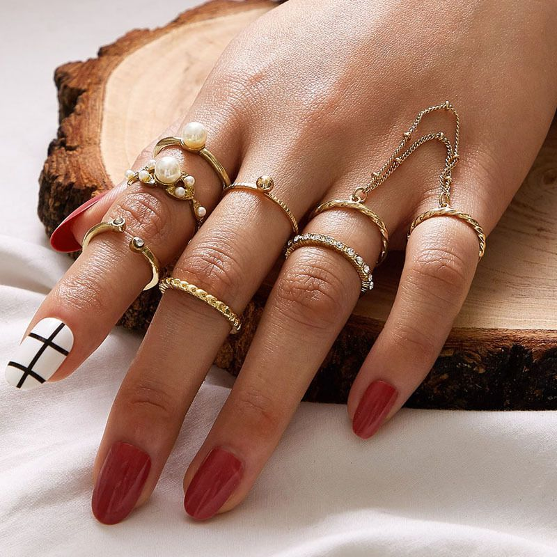 Fashion lady pearl chain ring alloy ring 7-piece set with diamond twist open ring set wholesale nihaojewelry NHGY236374