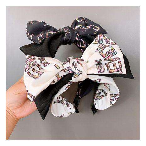 Coréen rétro mode anglais lettre Double Bowknot sauvage croix couture rayé bandeau épingle à cheveux accessoires nihaojewelry NHHD236513's discount tags