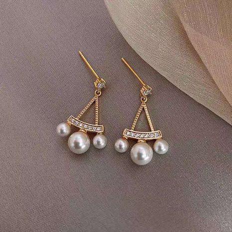 Mode simple nouvelle aiguille en argent 925 triangle creux boucles d'oreilles en perles nihaojewelry en gros NHXI236871's discount tags