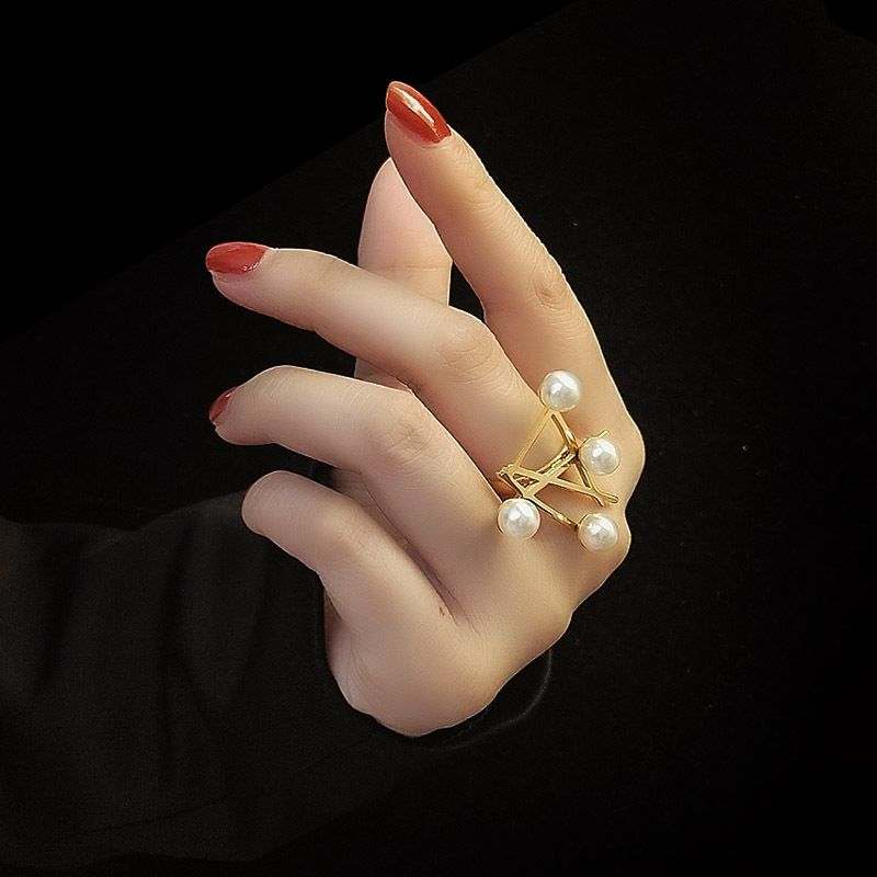 Cross symbol magazine style pearl exaggerated fashion ring titanium steel material rings wholesale nihaojewelry NHOK237166