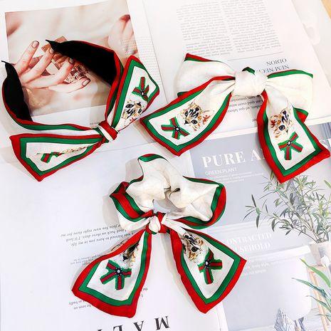 Kitty coreano big bow hair band retro seda horquilla raya impresión diadema venta al por mayor nihaojewelry NHUX237179's discount tags