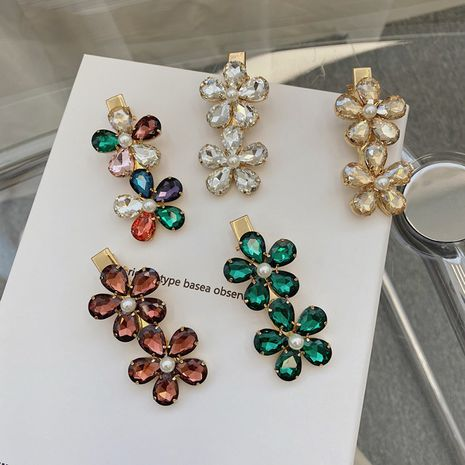 Korean crystal pearl flower side clip retro alloy rhinestone hair clip hairpin bangs clip wholesale nihaojewelry NHSM237094's discount tags