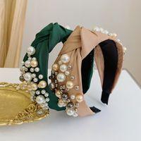 Diadema de moda tela de color sólido banda para el cabello anudada paquete de cabello de perlas retro para mujer diadema de bowknot simple NHSM237098
