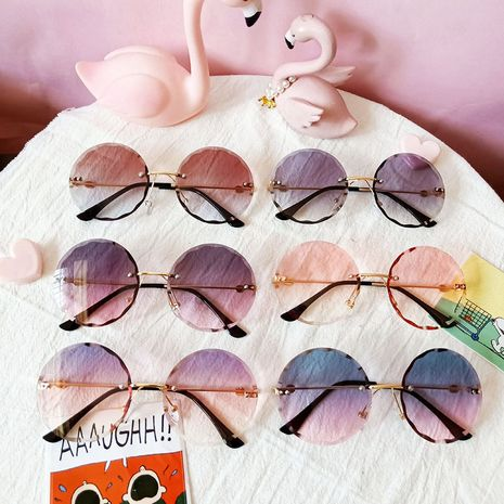 Children's sunglasses new fashion rimless cut-edge ocean piece sunglasses wave lace sunglasses wholesale nihaojewelry NHBA237690's discount tags