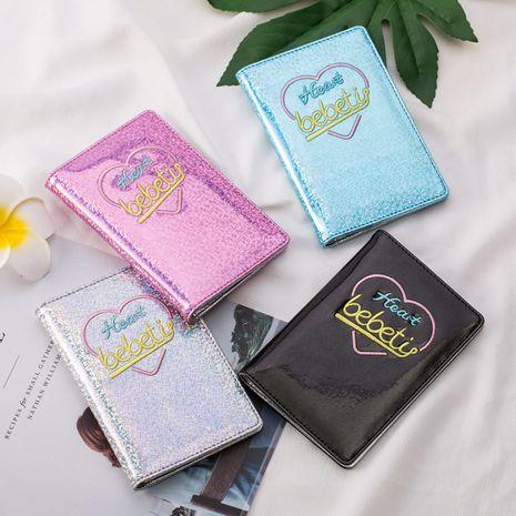 Funda de pasaporte láser de corazón de melocotón de moda Funda de documento multifuncional para niña coreana Porta pasaporte nihaojewelry NHBN237993's discount tags