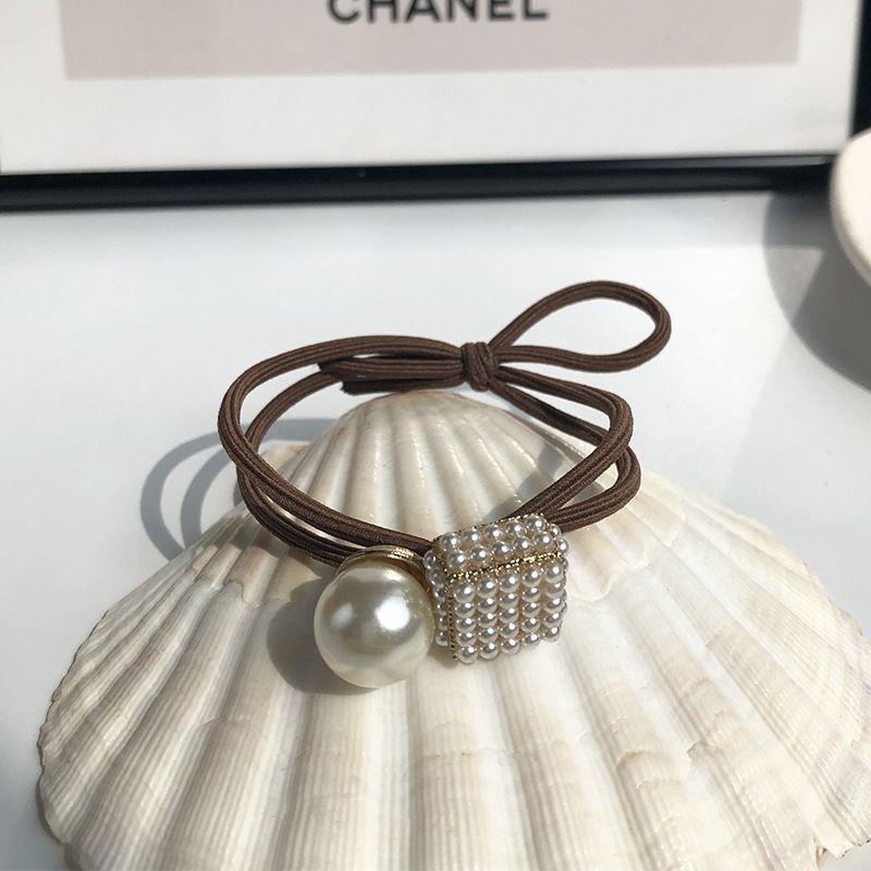 Fashion geometric pearl head rope Korean simple tie hair rubber band hair ring simple hair rope for women nihaojewelry NHWF238059