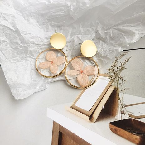 été coréen nouveau style géométrique boucles d'oreilles fleur rondes résine fleurs séchées boucles d'oreilles bijoux de mode en gros nihaojewelry NHWF238084's discount tags
