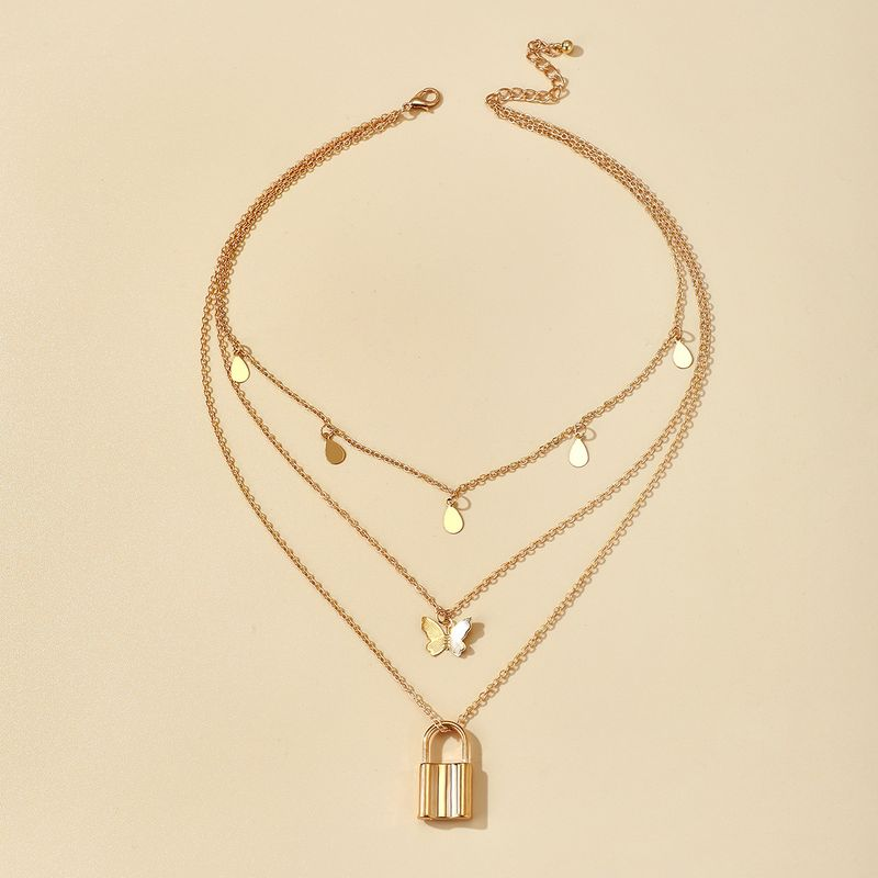retro fashion jewelry fashion lock butterfly disc necklace tassel multilayer clavicle chain wholesale nihaojewelry NHGY238200
