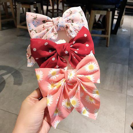 Style rétro pastoral coréen mignon vague florale dot arc en épingle à cheveux chrysanthème hirondelle noeud bec de canard clip en gros nihaojewelry NHDQ238282's discount tags