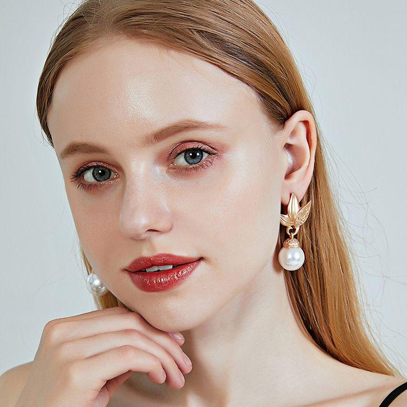 new earrings S925 pure silver earrings pearl earrings leaf earrings wholesale nihaojewelry NHOA238469