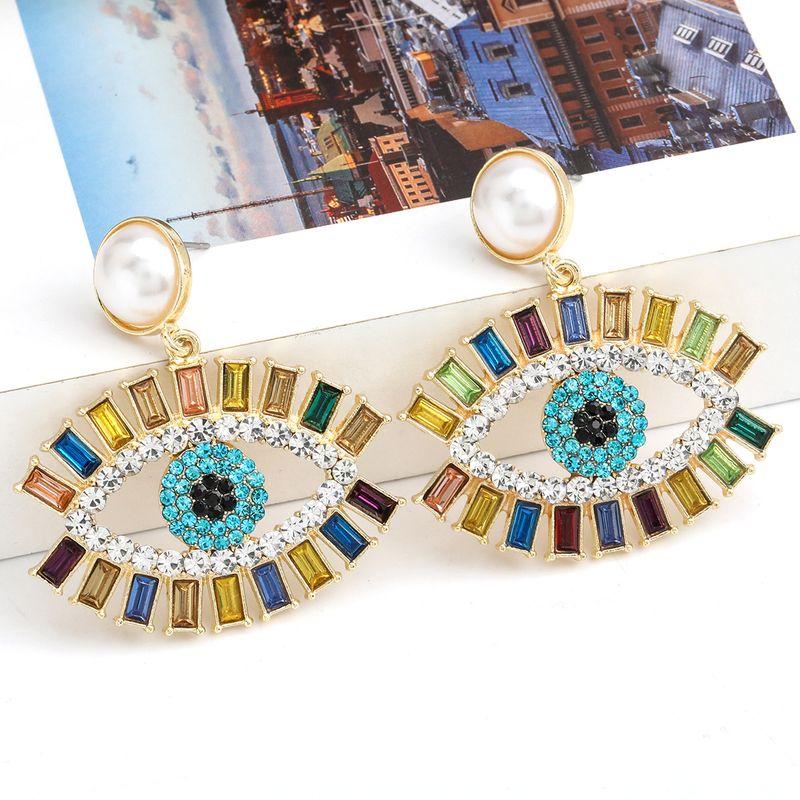 Fashion color diamond series alloy diamond inlaid pearl eye earrings exaggerated retro earrings wholesale nihaojewelry NHJE238817