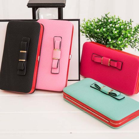 The new Korean matte leather bow tie long wallet clutch purse mobile phone bag wholesale nihaojewelry NHBN231163's discount tags