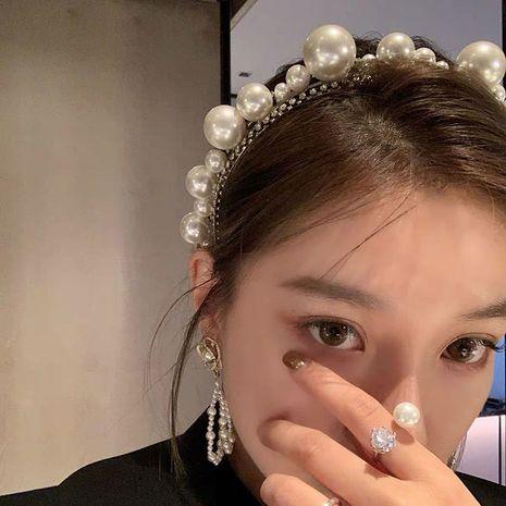 Diadema de perlas de tamaño dulce de Corea Diadema de hadas blancas retro Diadema de diamantes de imitación de cristal al por mayor nihaojewelry NHYQ231184's discount tags
