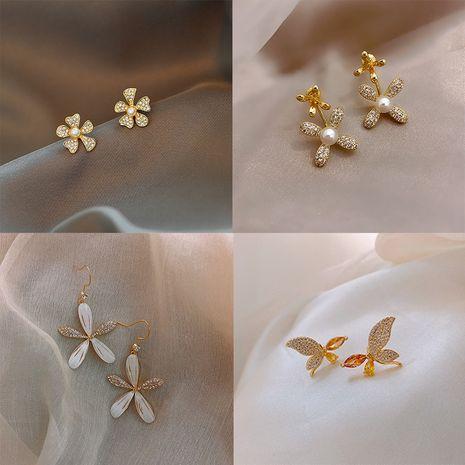 S925 silver needle Korean flower simple small butterfly diamond earrings wholesale nihaojewelry NHPF239559's discount tags
