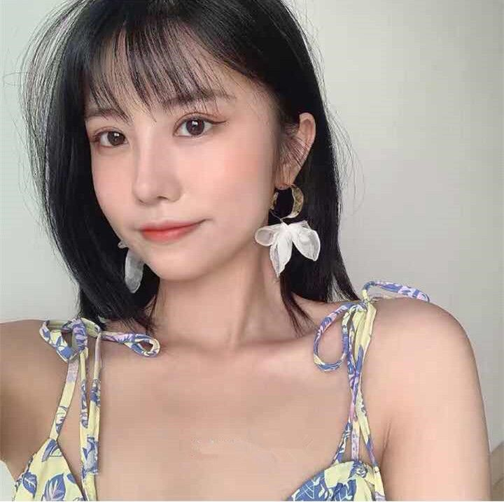 Korea's new beautiful concave shape irregular metal lace bow earrings wholesale nihaojewelry NHYQ239633
