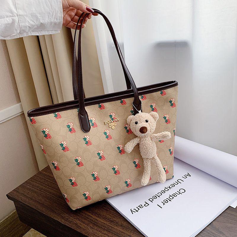 Large-capacity shopping bag  new female bag  Korean fashion trendy  simple tote large bag strawberry pattern handbag wholesale NHGA231620
