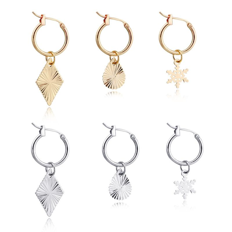 Korean exquisite small earrings simple laser water droplet snowflake diamond alloy pendant ear buckle wholesale nihaojewelry NHGO231948