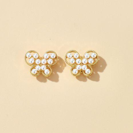 S925 argent aiguille douce simple petit papillon boucles d'oreilles fille coeur sauvage perles boucles d'oreilles en gros nihaojewelry NHGY231962's discount tags