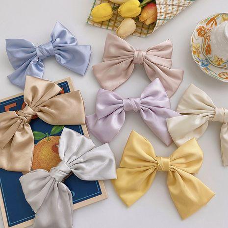 Korean satin big bow hairpin girl spring clip head hairpin headdress wholesale nihaojewelry NHOF231093's discount tags