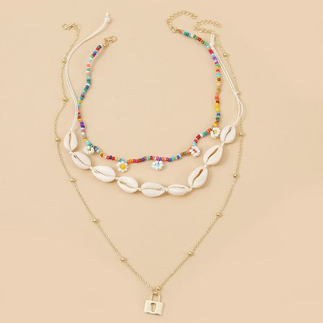 Bohème trois coquille fleurs riz perles multicouche collier tendance à la main long pendentif bijoux en gros nihaojewelry NHLA232208's discount tags