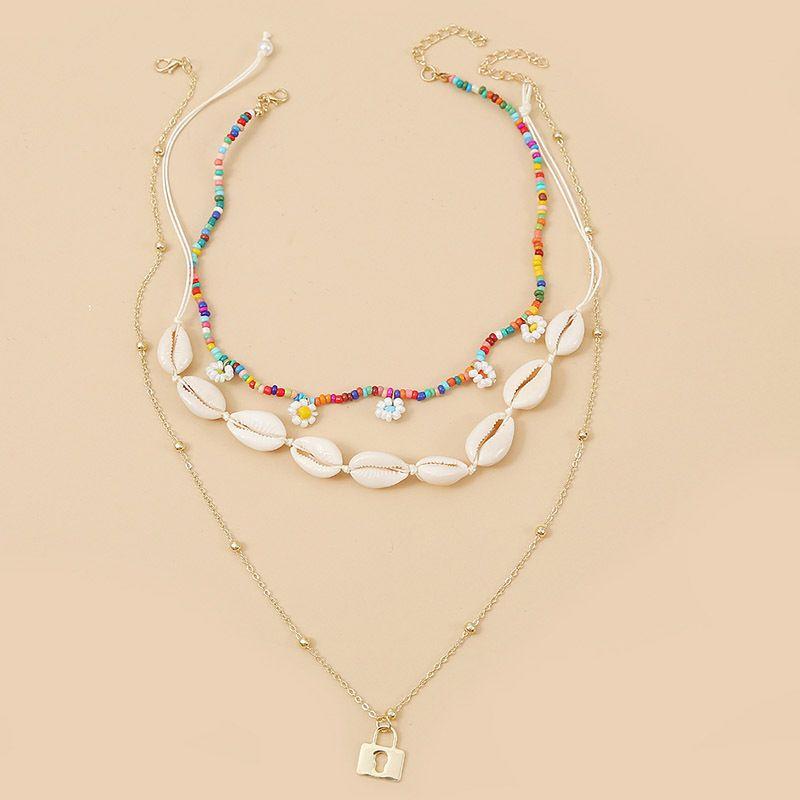 Bohemian three shell flowers rice beads multilayer necklace trend handmade long pendant jewelry wholesale nihaojewelry NHLA232208