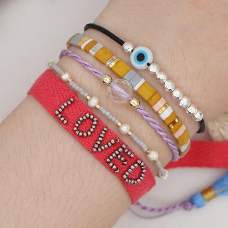 Verano playa estilo arco iris tila cuentas de arroz letras tejidas moda pulsera de perlas naturales al por mayor nihaojewelry NHGW232262's discount tags