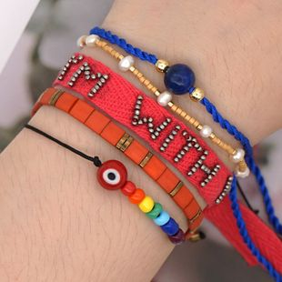 Summer beach wind rainbow tila rice bead bracelet woven letters fashion natural pearl handmade wholesale nihaojewelry NHGW232265's discount tags