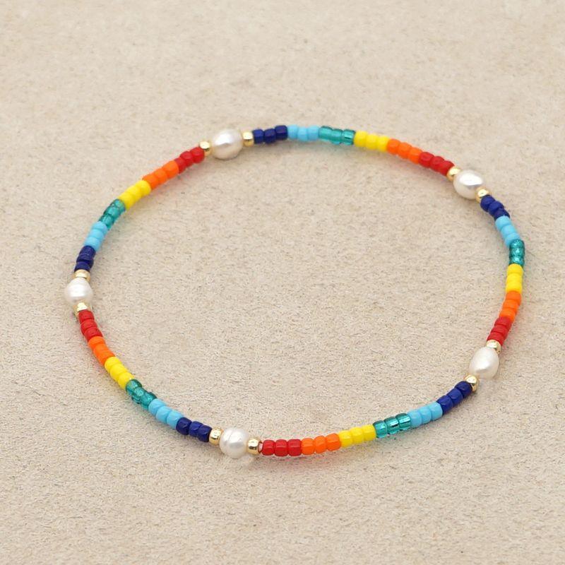 Korean style fashion rainbow small bracelet MGB rice beads woven Baroque natural pearl handmade wholesale nihaojewelry NHGW232273