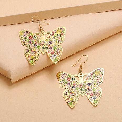 Boucles d'oreilles peintes en émail métallique tendance simple exagérées boucles d'oreilles papillon creuses sauvages en gros nihaojewelry NHKQ232333's discount tags