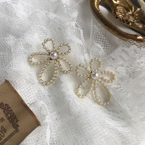 boucles d'oreilles fleur creuse 925 argent perle diamant boucles d'oreilles Français rétro boucles d'oreilles nouveau gros nihaojewelry NHWF232380's discount tags