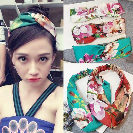 Nueva moda coreana geranio flor letra satén elástico viga cruzada diadema nihaojewelry al por mayor NHSA232905's discount tags