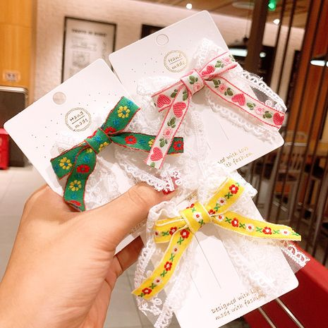 Serpentinas de encaje coreano floral arco pinza de pelo niños lindo dulce nacional viento flequillo clip tocado al por mayor NHSA233026's discount tags
