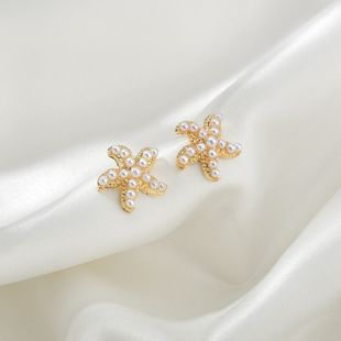 Korea small pearl simple and versatile starfish shell earrings wholesale nihaojewelry NHBQ239988's discount tags