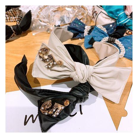 Korean retro leather rhinestone bow hair band head accessories wholesale nihaojewelry NHHD240258's discount tags