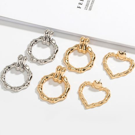Korea new minimalist retro bamboo high fashion design peach heart stud earrings NHAI242941's discount tags
