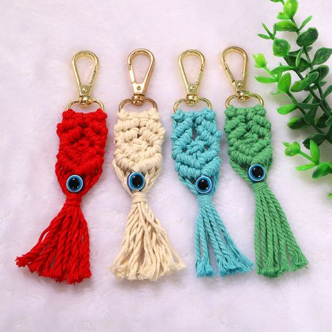 The new metal buckle color cotton sliver hand-woven eye pattern tassel keychain wholesale nihaojewerly NHJQ243067's discount tags